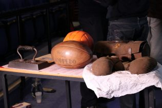 Rugby balls on a table in a old-fashioned workshop | Kelly Evans